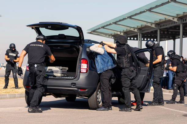 Customs and border protection officers Customs and border protection officers and Drug enforcement administration special forces participate in a training at the airport for searching and seizing of illegal drugs. Unrecognizable people in black. counter terrorism stock pictures, royalty-free photos & images