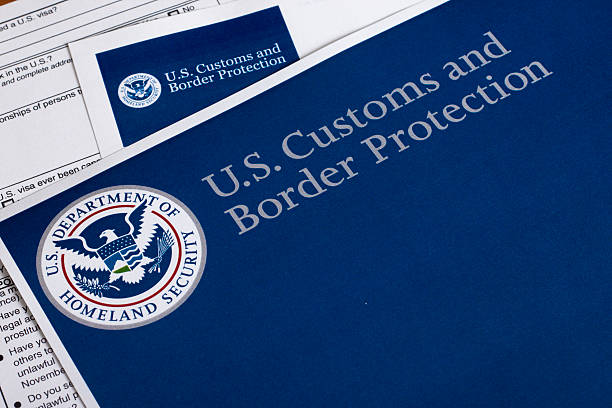 US Customs and Border Protection US Customs and Border Protection form to fill out customs official stock pictures, royalty-free photos & images