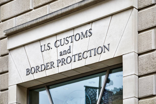 US Customs and Border Protection Sign Washington DC, USA - September 14, 2018: Sign above the entrance to the US Customs and Border Protection building  on 14th Street department of homeland security stock pictures, royalty-free photos & images