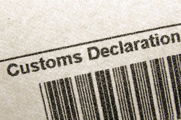 customs declaration fragment of customs declaration document with bar-code customs official stock pictures, royalty-free photos & images