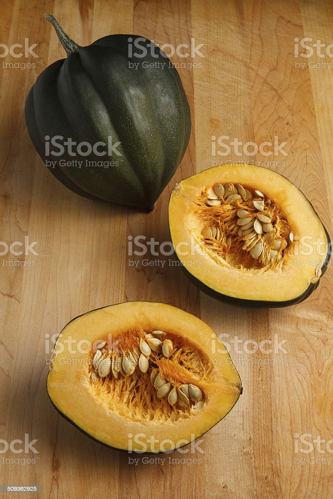 Cut Acorn Squash on a cutting board stock photo