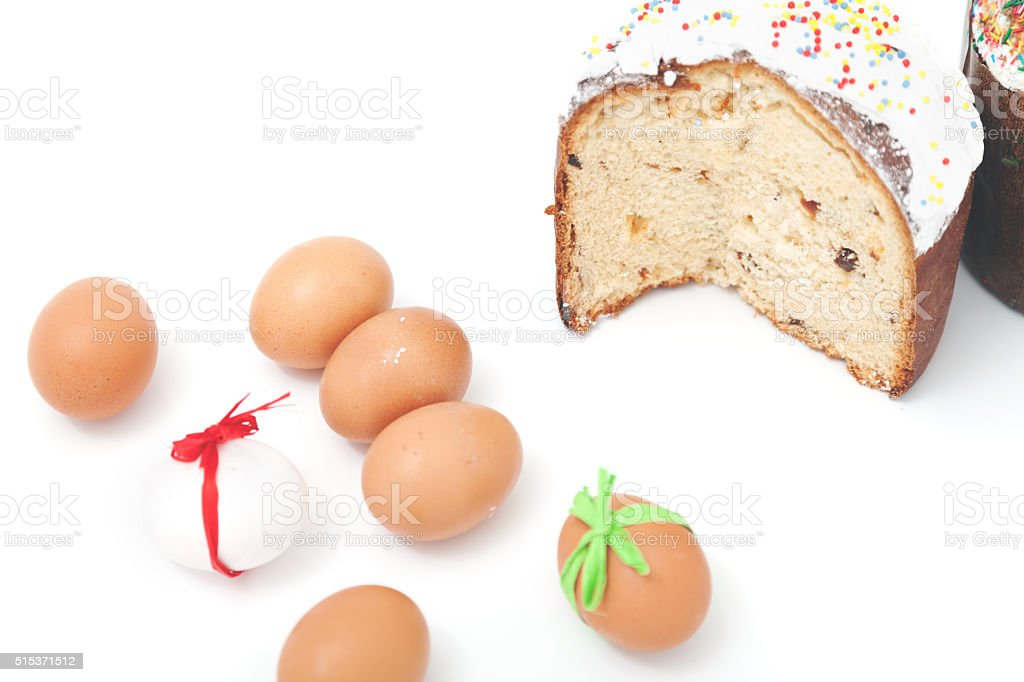 Cut and Easter colored eggs on a white background stock photo