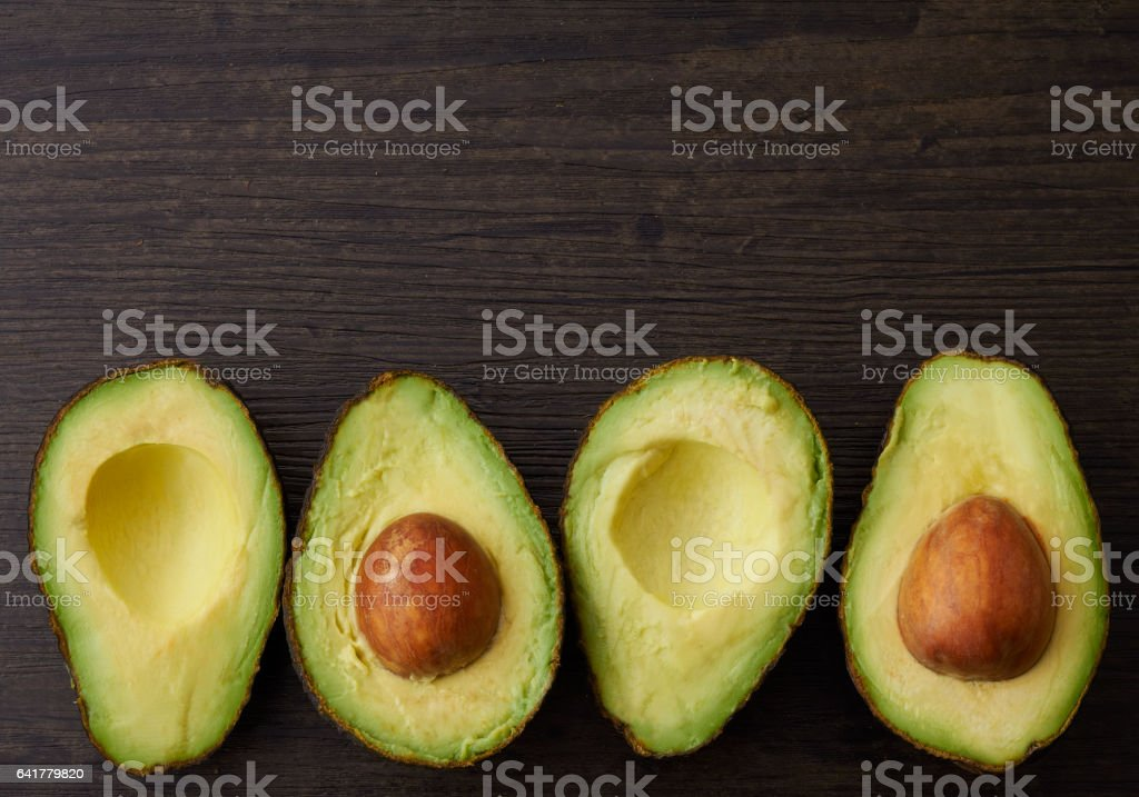 Cut Avocado halves and seeds stock photo