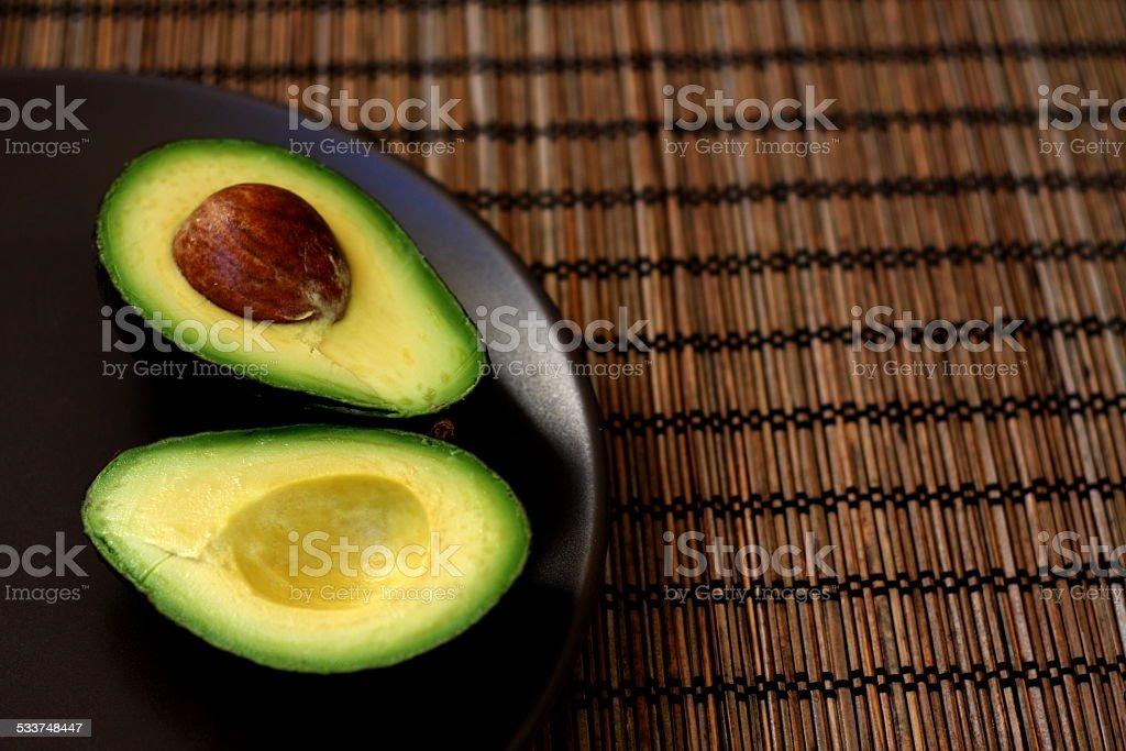 Cut Avocado on a Plate stock photo