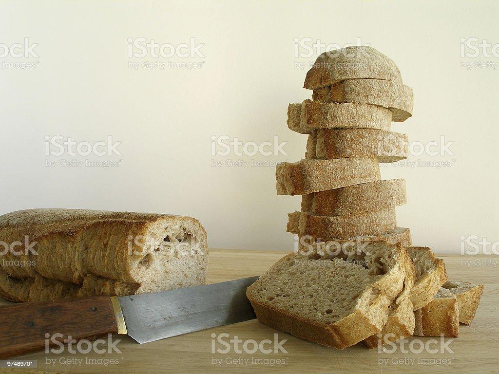 Cut bread on cutting board royalty-free stock photo