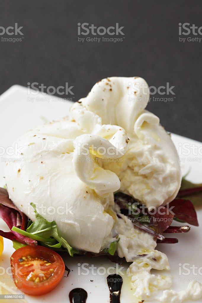 Cut buratta cheese closeup stock photo