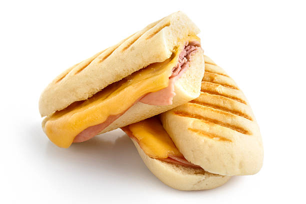 cut cheese and ham toasted panini melt. - cheese sandwich bildbanksfoton och bilder