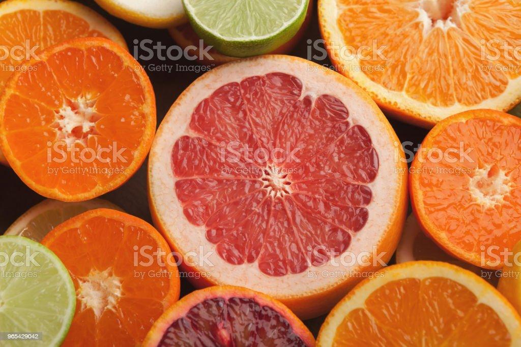 Cut citruses closeup. Juicy background zbiór zdjęć royalty-free