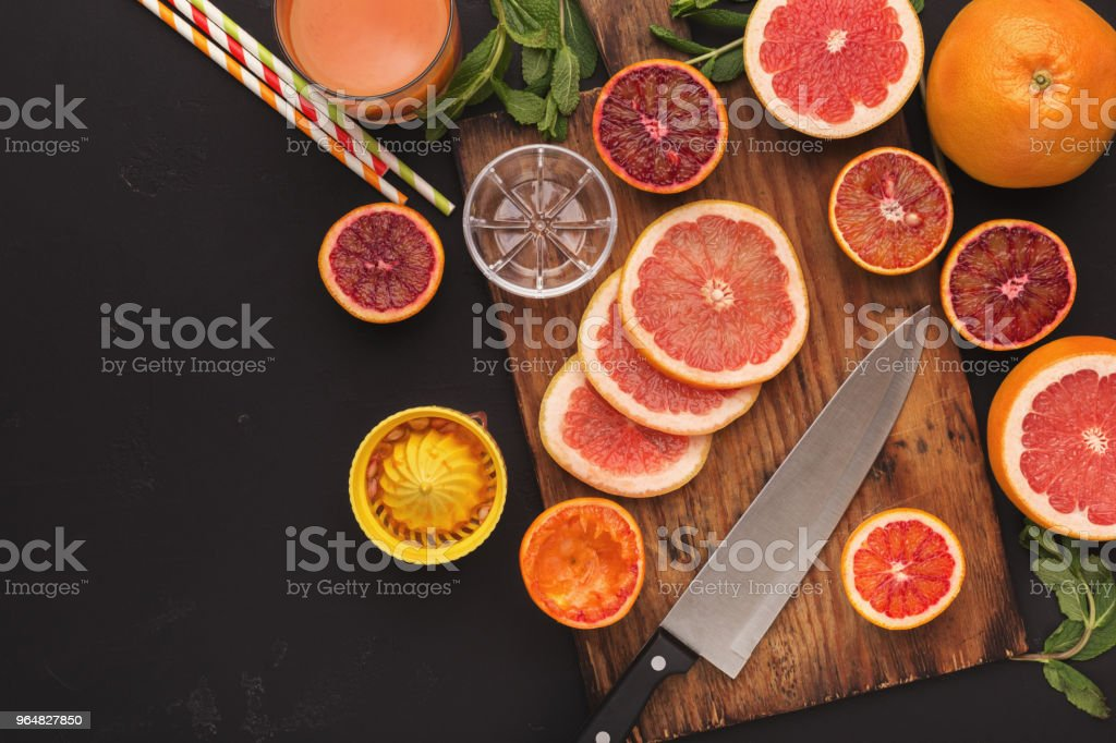 Cut citruses, top view. Juicy background royalty-free stock photo