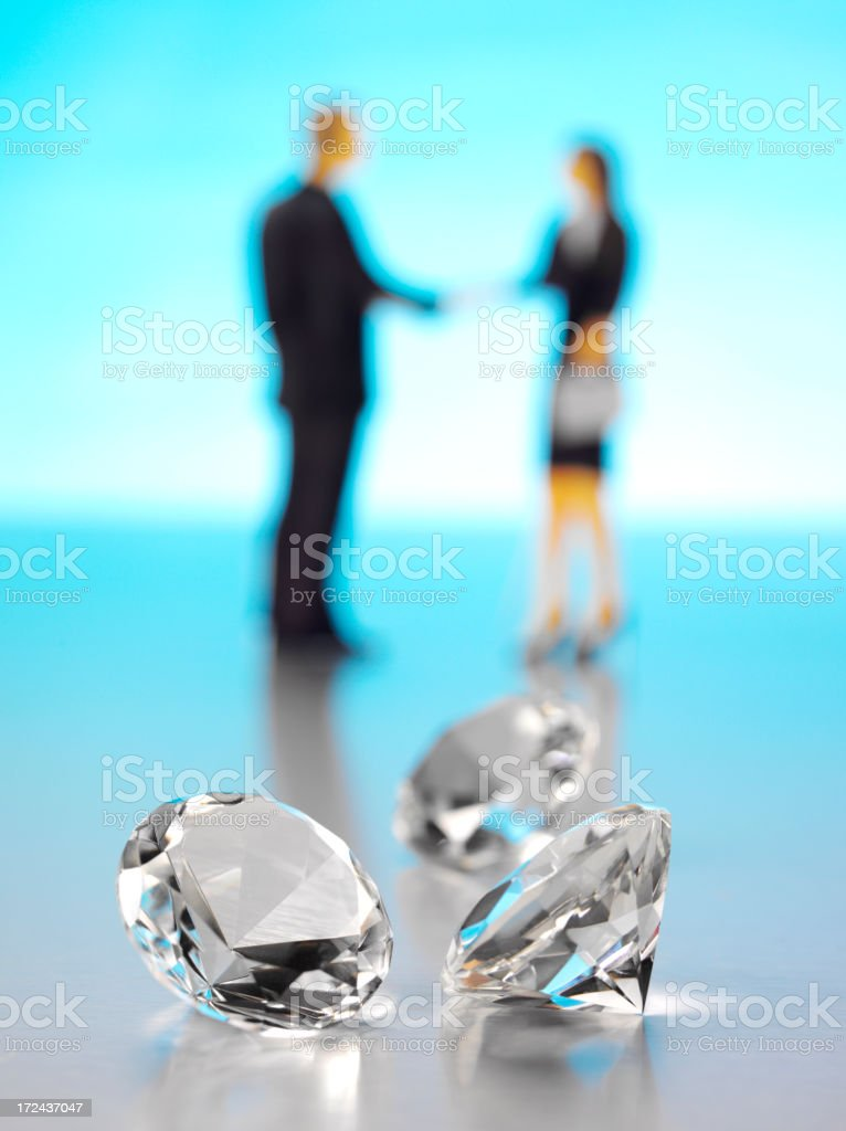 Cut Diamonds with a Businessman and Women royalty-free stock photo