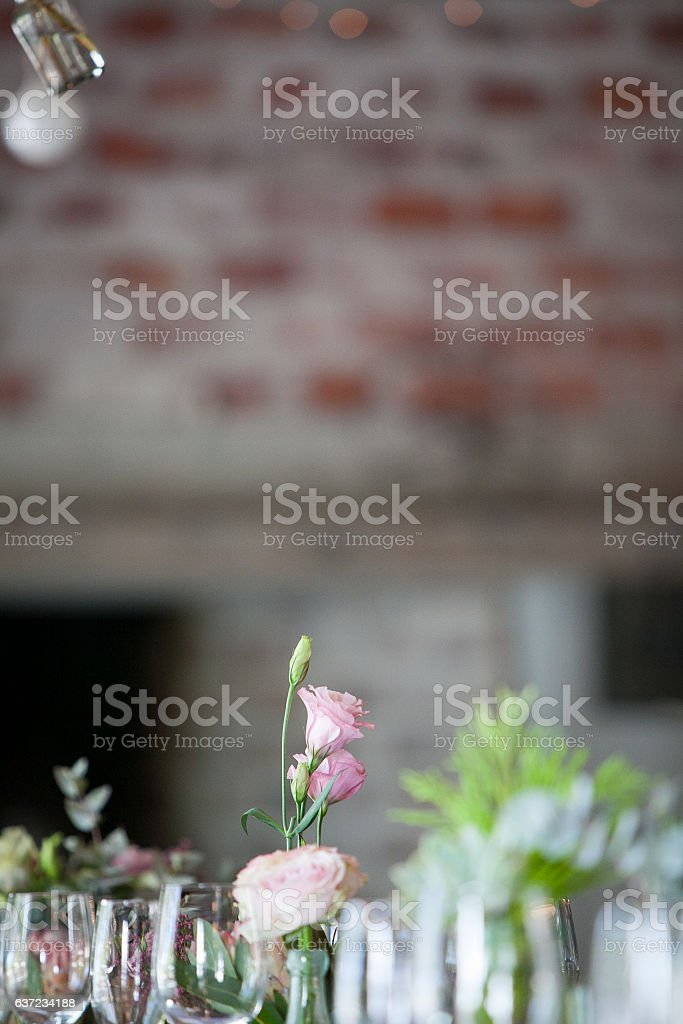 Cut flowers and glasses on the wedding table stock photo