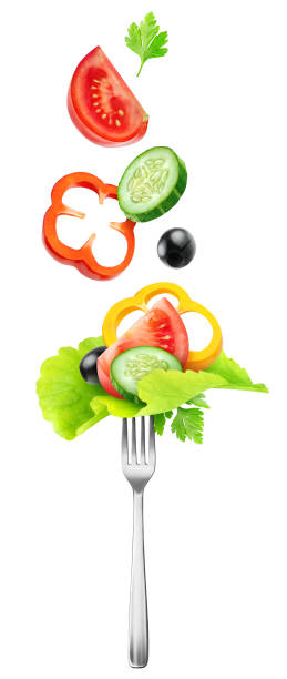 Cut fresh vegetables over a fork stock photo