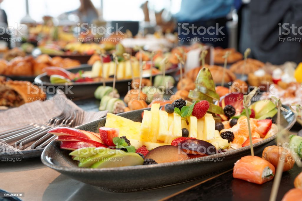 Cut fruits and another dishes stock photo