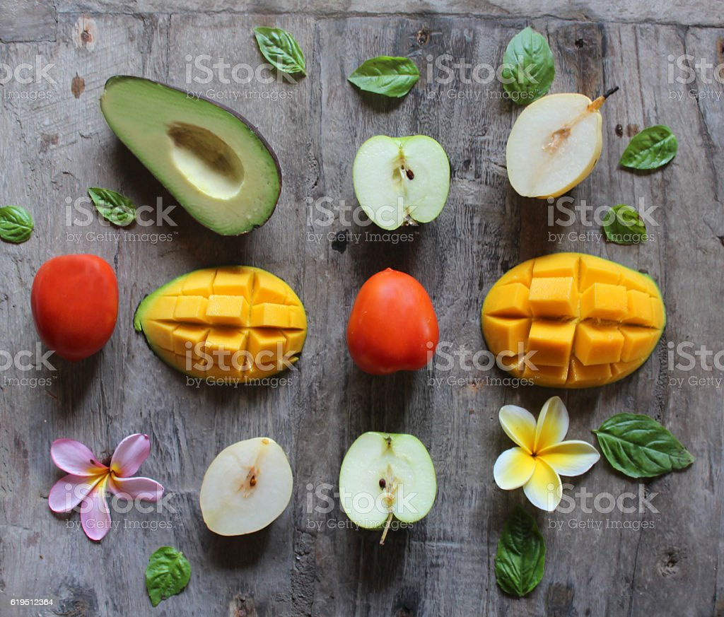 Cut fruits on a wooden table stock photo