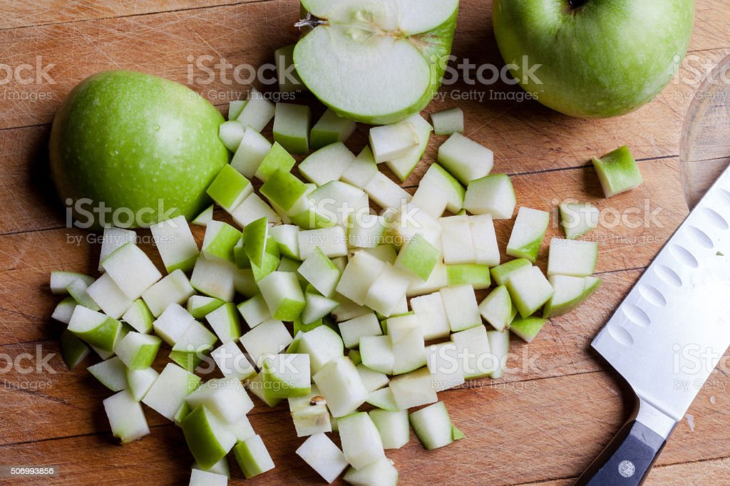 Cut green apples from above with knife stock photo