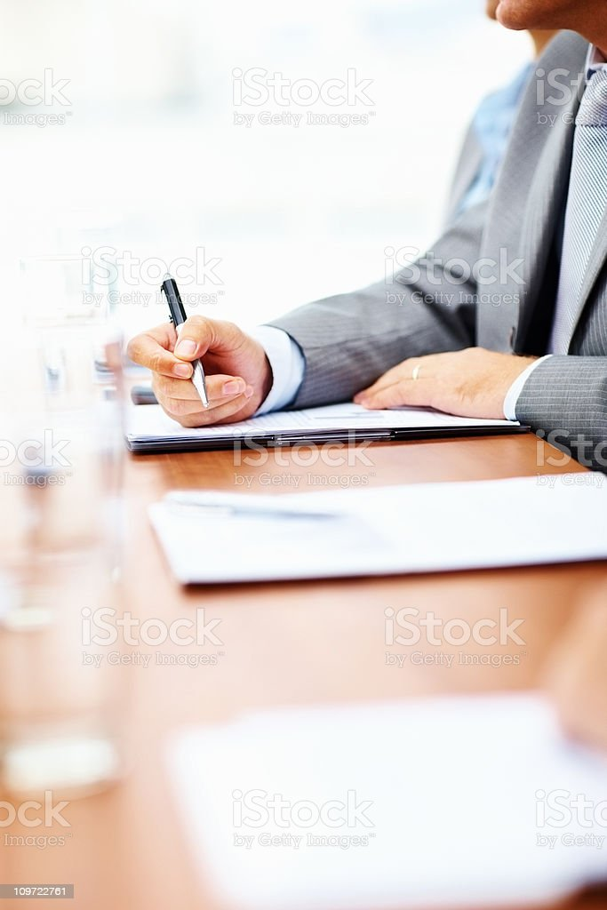 Cut image of a business man making notes royalty-free stock photo