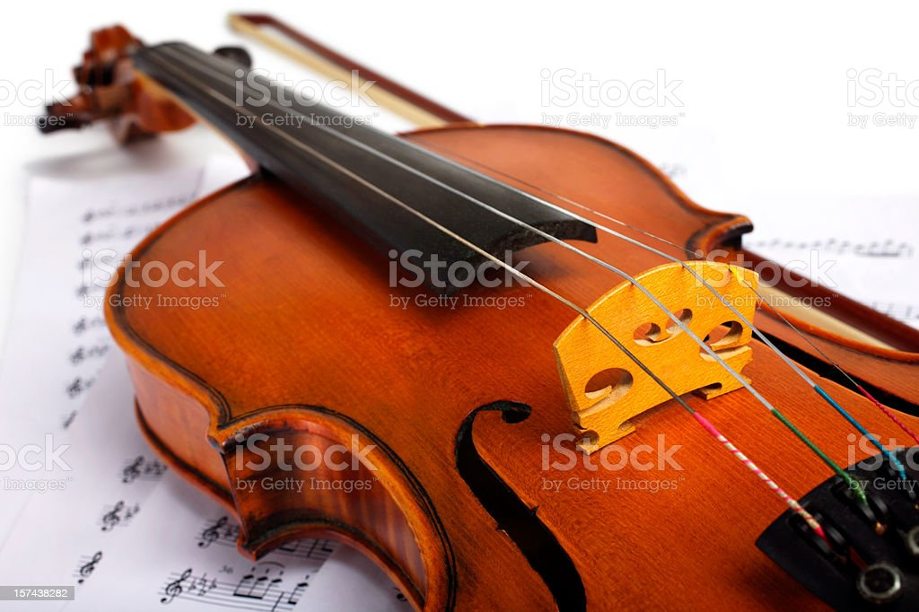 Cut image of a violin placed on musical notes royalty-free stock photo