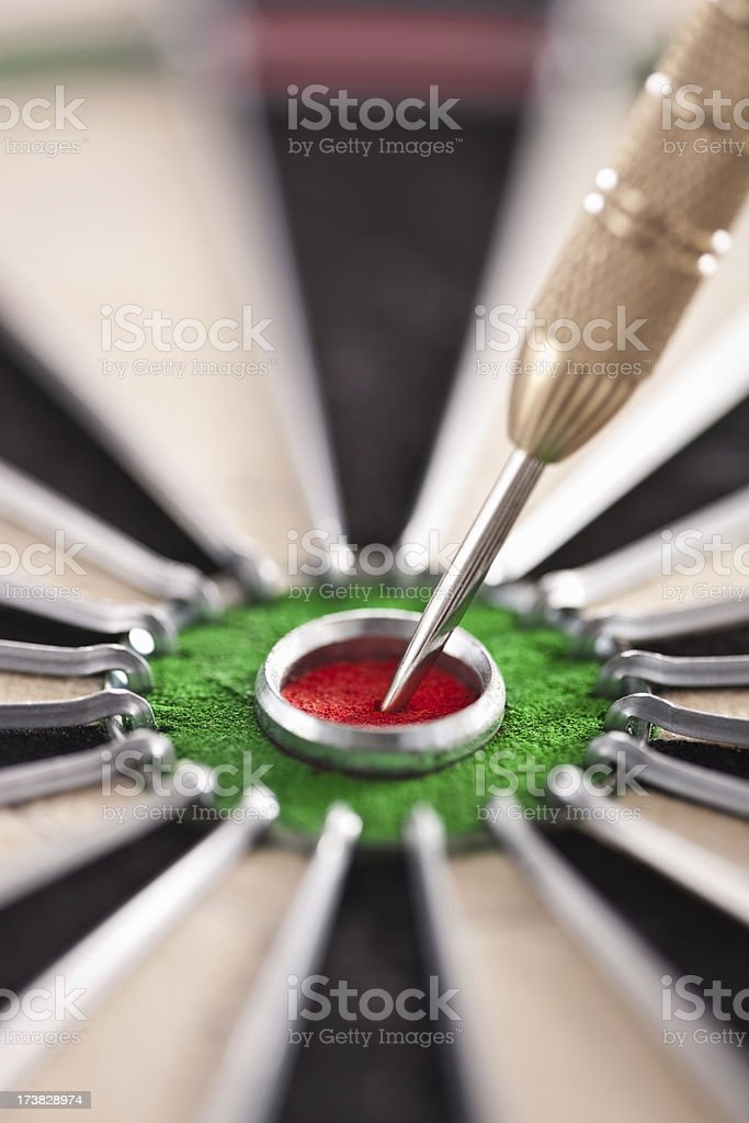 Cut image of dart pierced on target over dartboard royalty-free stock photo
