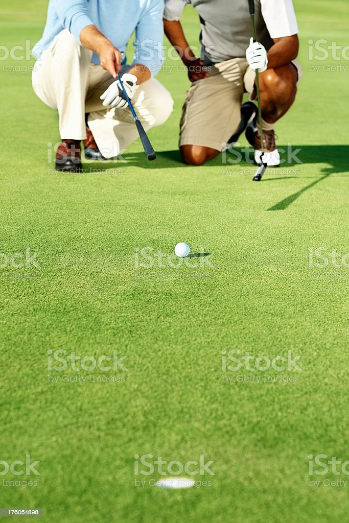 Cut image of golfers taking aim royalty-free stock photo