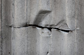 Cut in corrugated metal sheet