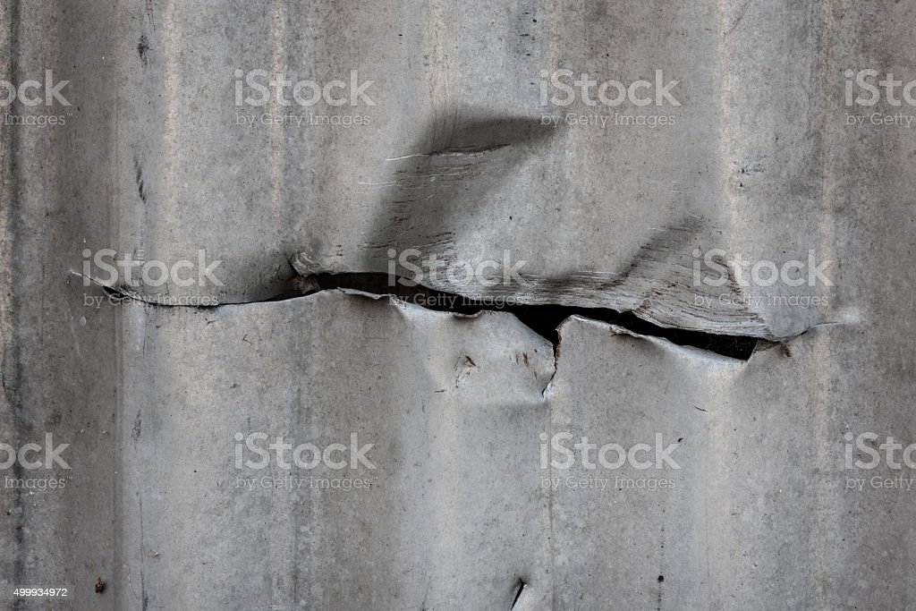 Cut in corrugated metal sheet stock photo
