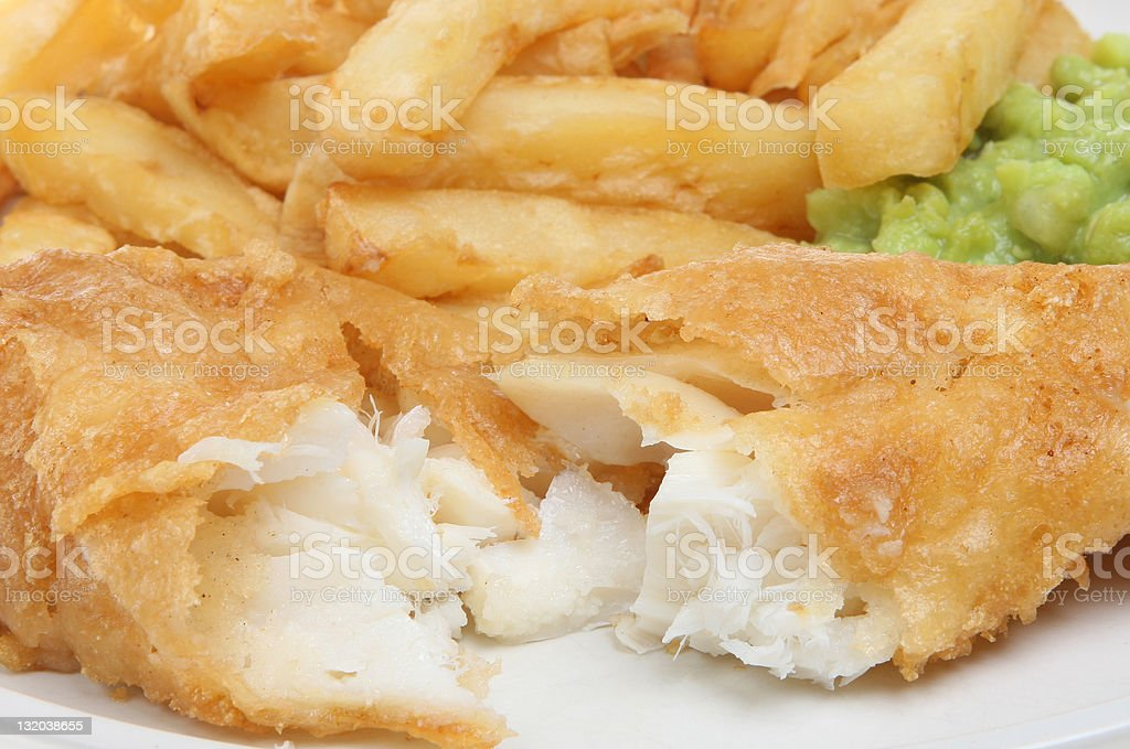 Cut in half fish with chips and guacamole stock photo