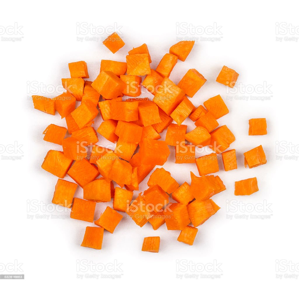 cut into squares pieces of carrot on a white background stock photo