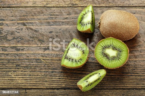 Cut Kiwi On A Wooden Background The Texture Of The Fruit Is Clearly Visible Stock Photo & More Pictures of Antioxidant