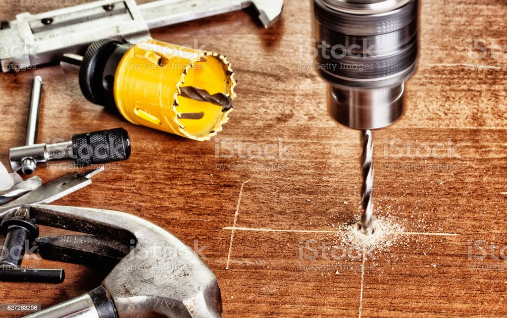 Cut large holes using a manual electric tools stock photo