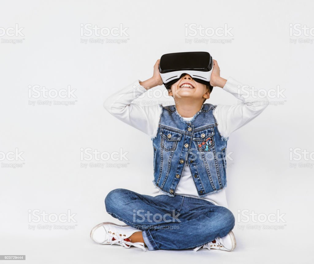 Cut little girl experiencing virtual reality eyeglasss headset stock photo