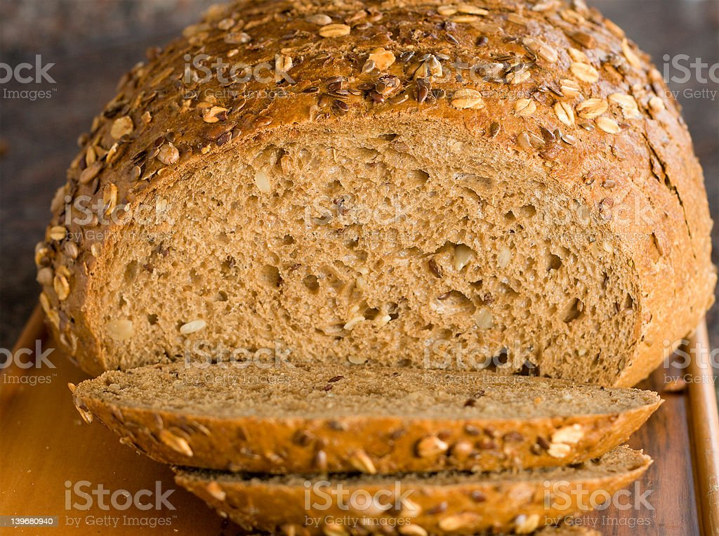 Cut loaf of brown bread with seeds royalty-free stock photo