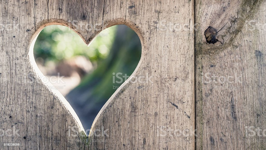 Cut log wood with lightening heart shape, background texture stock photo