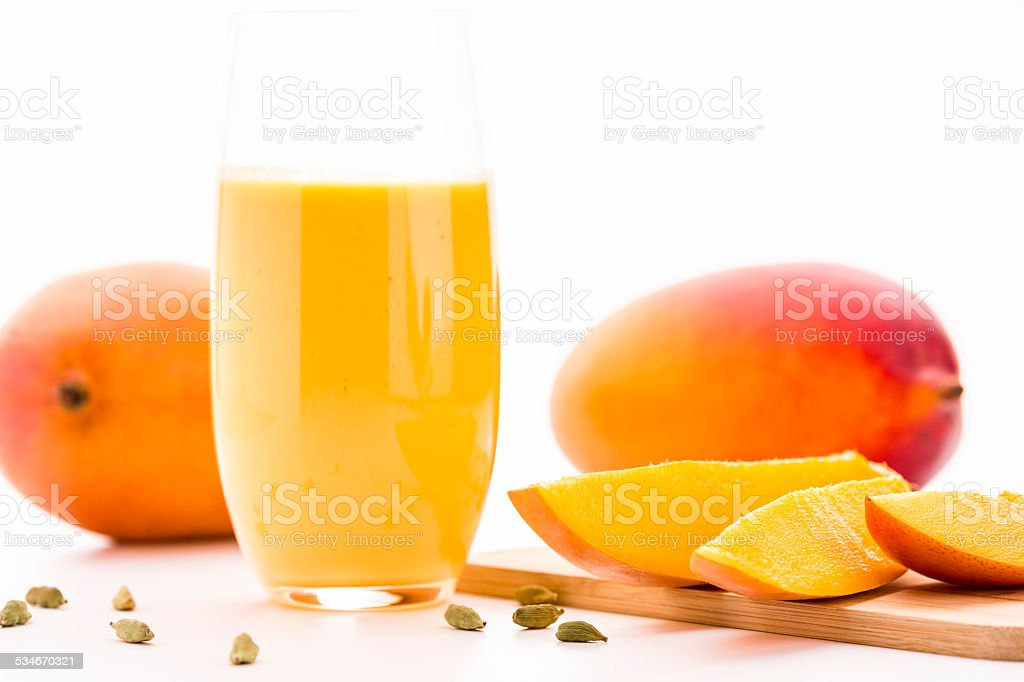 Cut Mango Pieces, Cardamon And Fruit Shake stock photo