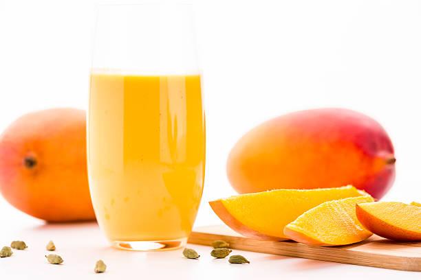 Cut Mango Pieces, Cardamon And Fruit Shake stock photo