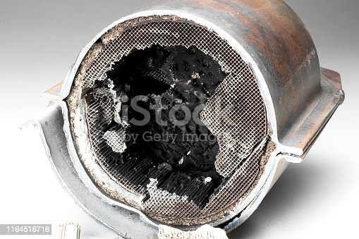 Cut muffler car with a platinum catalyst. Muffler of the exhaust system of the car on a white background.