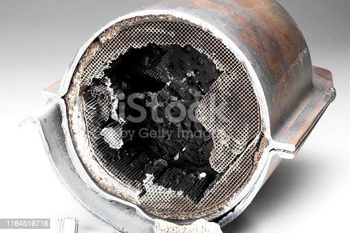 istock Cut muffler car with a platinum catalyst. 1164516716