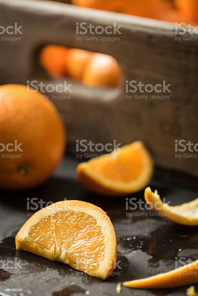 Cut Navel Orange in Front of a Wooden Crate royalty-free stock photo