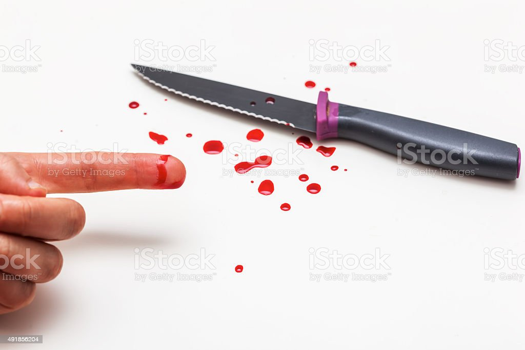 cut of finger while cooking. stock photo