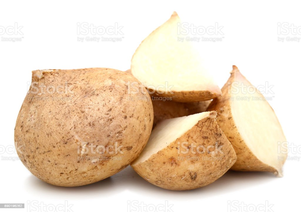 cut of jicamas at on white background stock photo
