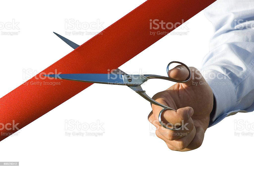 Cut of the red ribbon stock photo