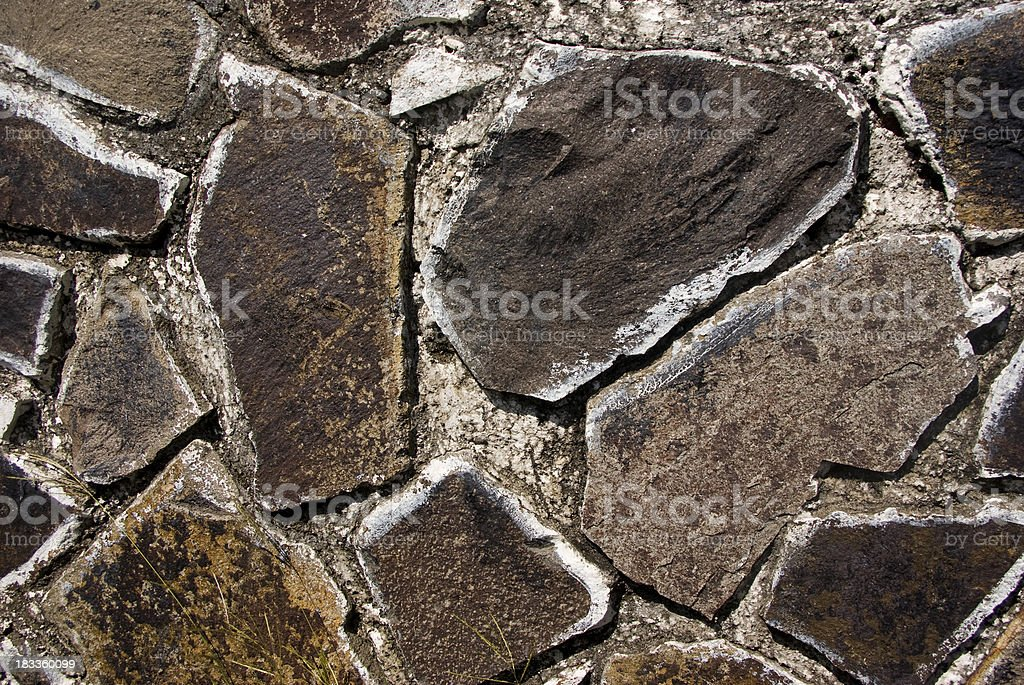 cut or chiselled stone wall close up royalty-free stock photo