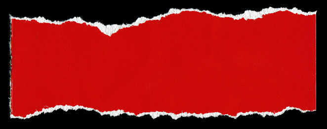 Cut or torn red paper textured background isolated on black