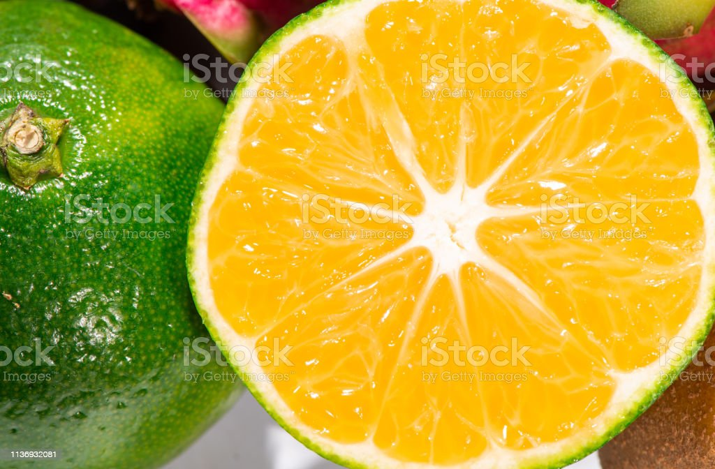Cut oranges and white background