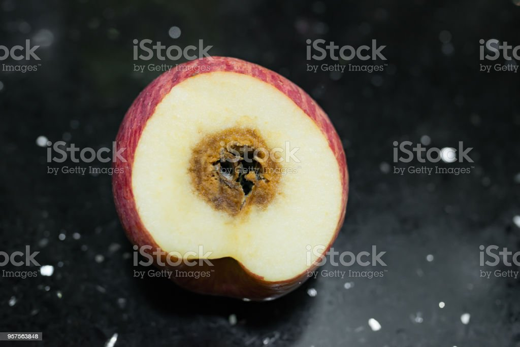 cut out apple rotten in the middle stock photo