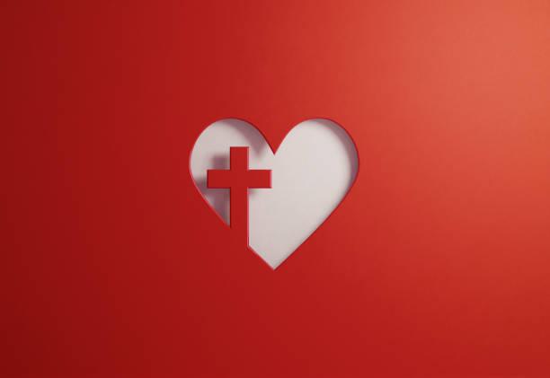 cut out heart shape with a cross on red background - good friday and faith concept - bóg zdjęcia i obrazy z banku zdjęć