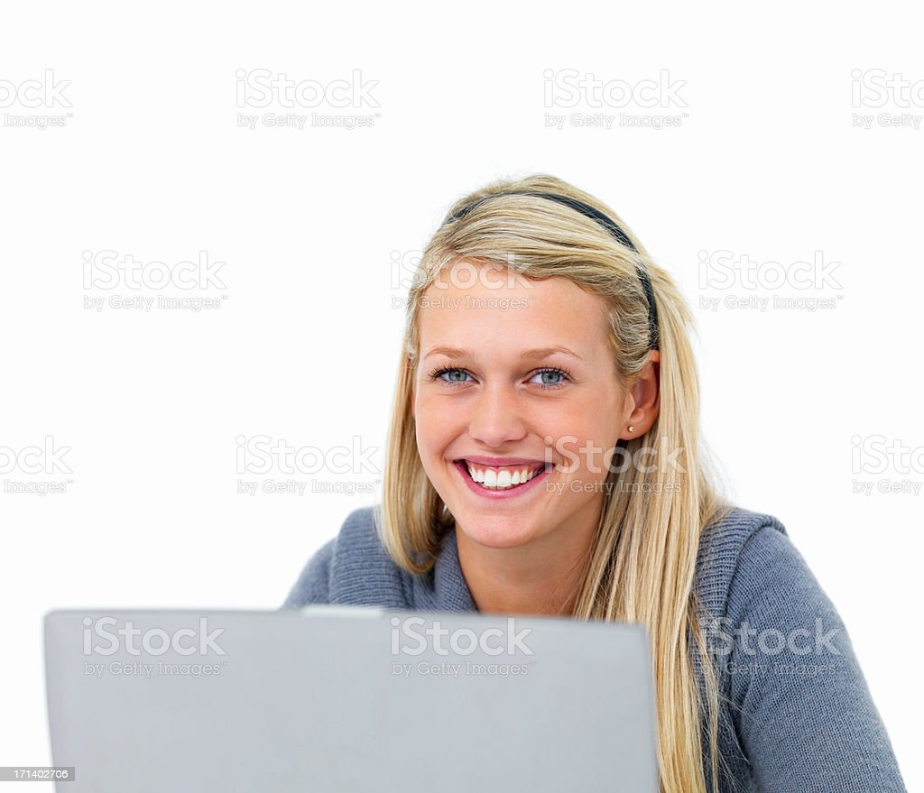 Cut out of a smiling lady working on a laptop royalty-free stock photo