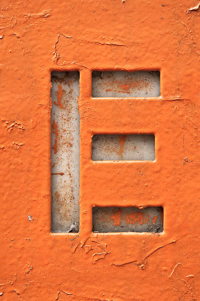 Cut out of the letter E in grunge style stock photo