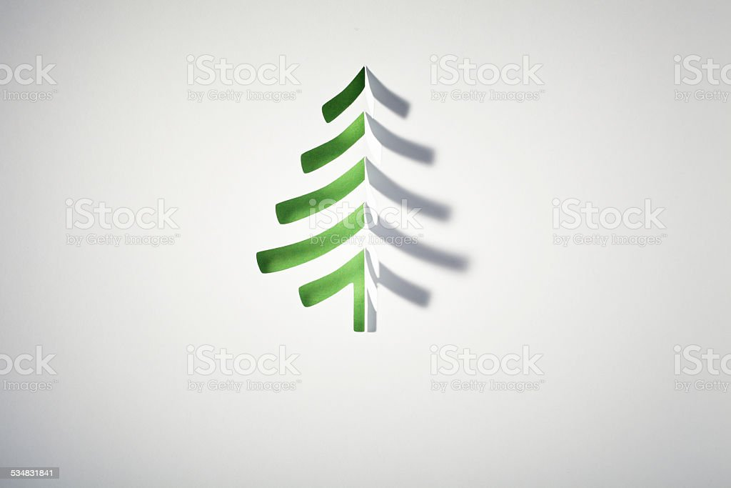 Macro photography of christmas tree shape cutted into a white sheet...