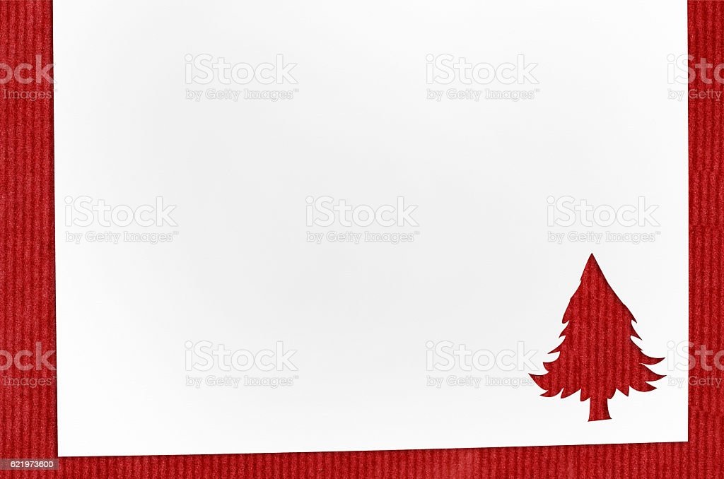 cut paper in fir-tree shape on table stock photo