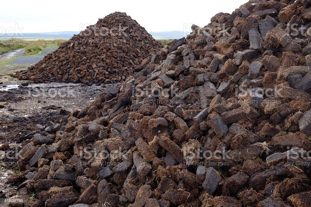 Cut peat piles stock photo